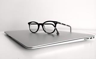 Macbook and glasses image (Photo via Pixabay by AlexBor)